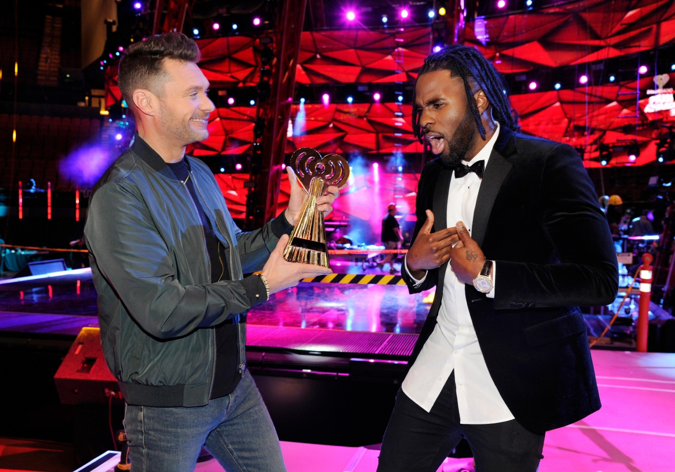 Host Ryan Seacrest, left, pretends to hand an award to singer Jason Derulo at the press preview day for the 2017 iHeartRadio Music Awards at The Forum on Thursday, March 2, 2017, in Inglewood, Calif. The annual pop music awards show will be held on Sunday at The Forum. (Photo by Chris Pizzello/Invision/AP)