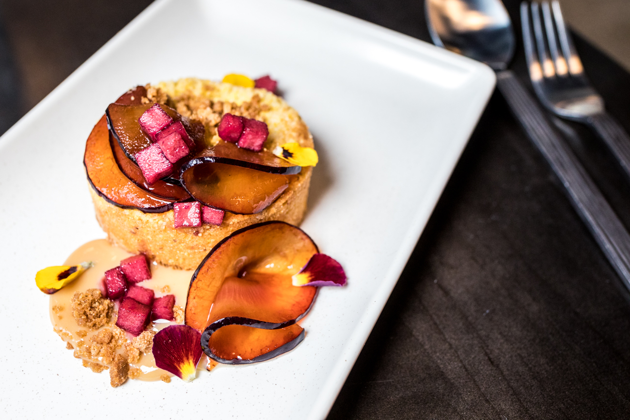 Cornmeal Cake: ras el hanout ice cream, cardamom plums, concord honey crisp, and caramelized milk jam / Image: Catherine Viox // Published: 11.18.20