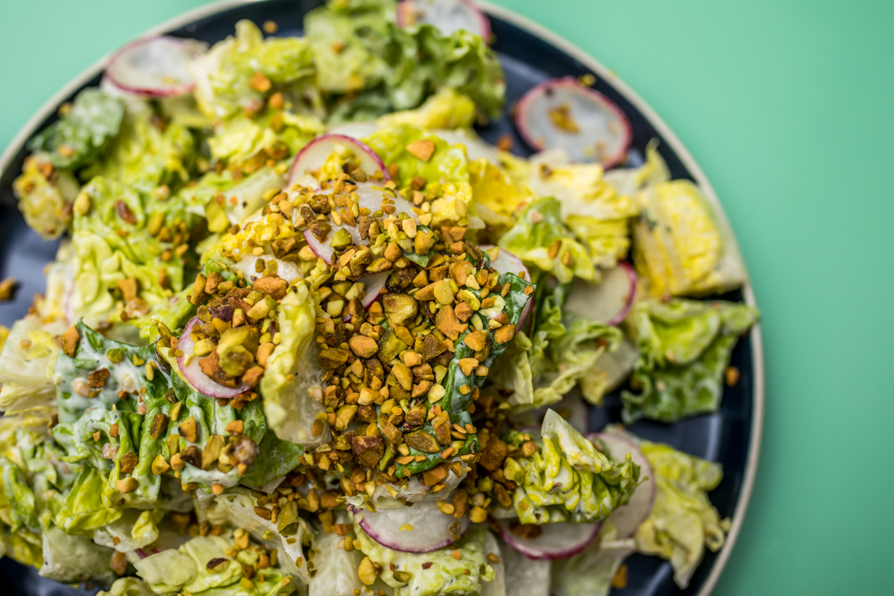 Little Gem Lettuces Salad: pistachio, creamy vinaigrette, and radish / Image: Catherine Viox // Published: 2.13.21
