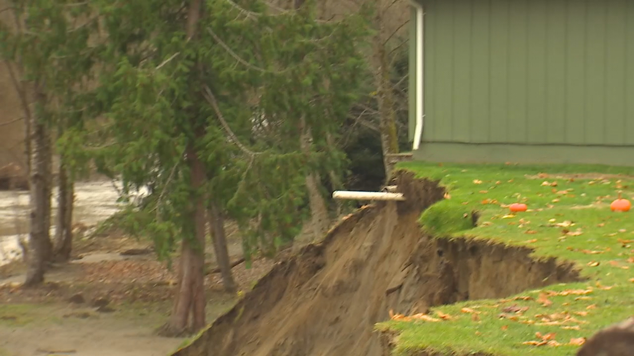 Even though flood waters are going down, the river continues to chew away at the bank. (Photo: KOMO News)