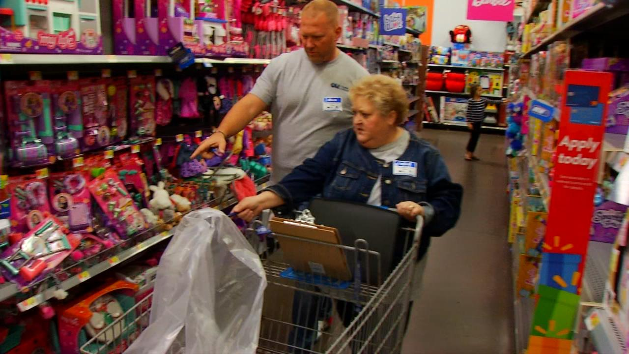 A Soldier's Child, a nationwide nonprofit, was on detail Friday in Buncombe County. Their marching orders -- buy about 900 gifts for 129 children of men and women who've given their lives for our nation. (Photo credit: WLOS staff)