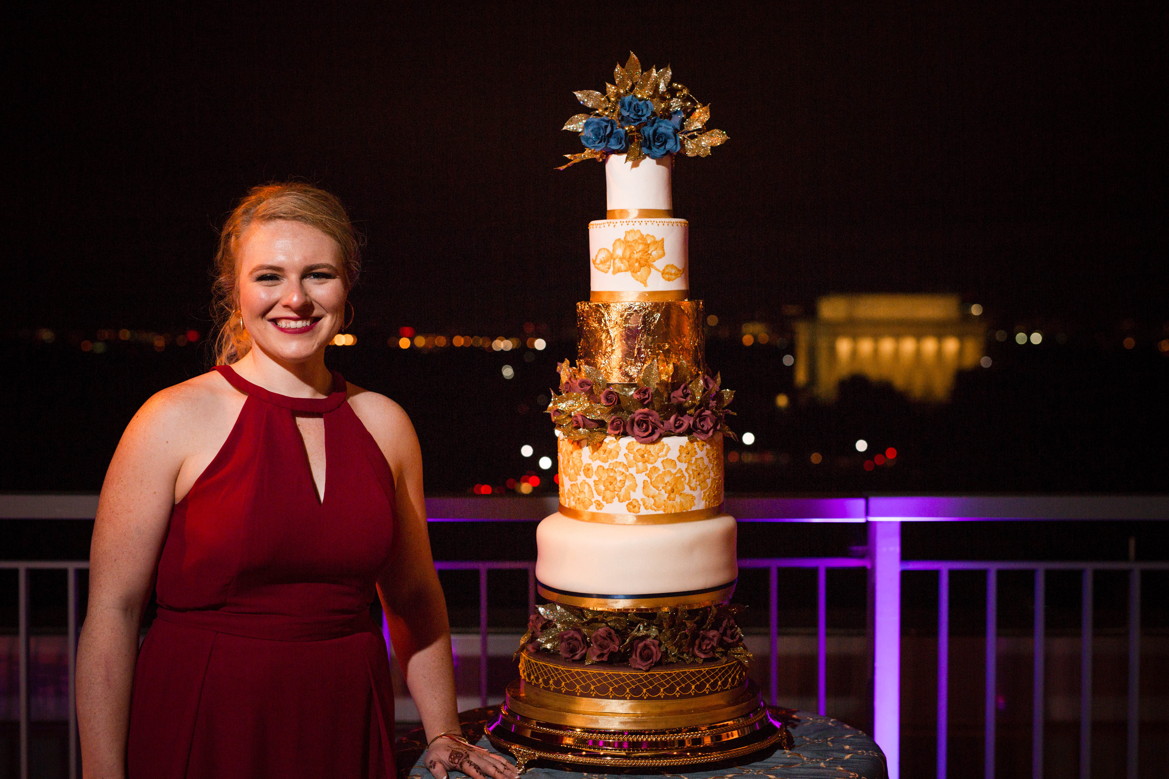 The groom's sister, Kelsey Burack, made a stunning cake for the couple's reception. (Image: Laura Bryan Photography){ }