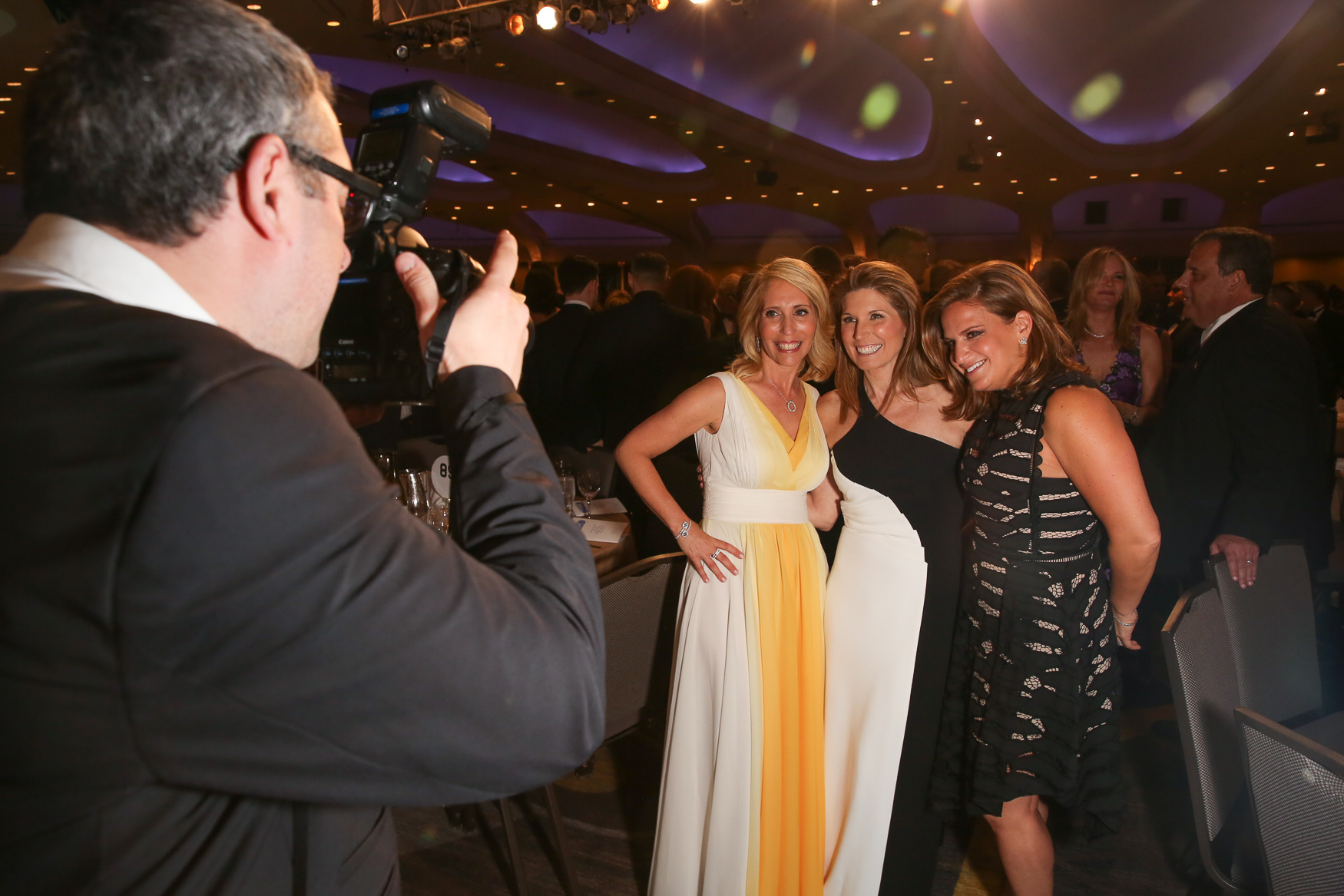 A photographer snaps a pic of Dana Bash and her colleagues.{ } (Amanda Andrade-Rhoades/DC Refined)