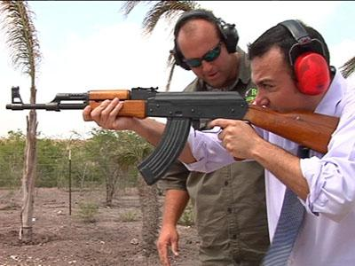 Action 4 News reporter Sergio Chapa tries out an AK-47
