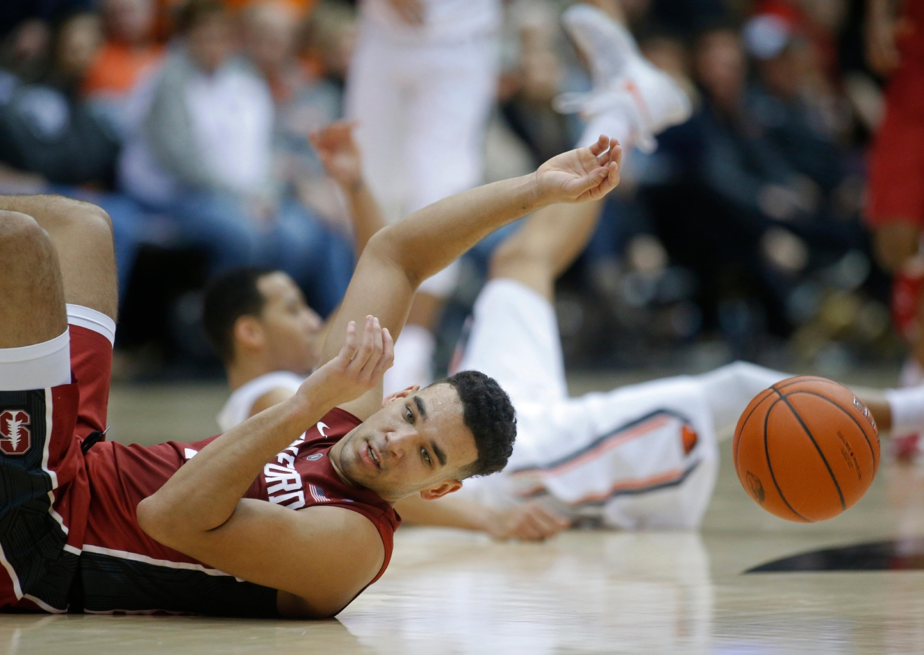 Stanford's Dorian Pickens hits the floor after being fouled while going after a loose ball during the second half of the team's NCAA college basketball game against Oregon State, in Corvallis, Ore., Thursday, Jan. 19, 2017. Stanford won 62-46. (AP Photo/Timothy J. Gonzalez)