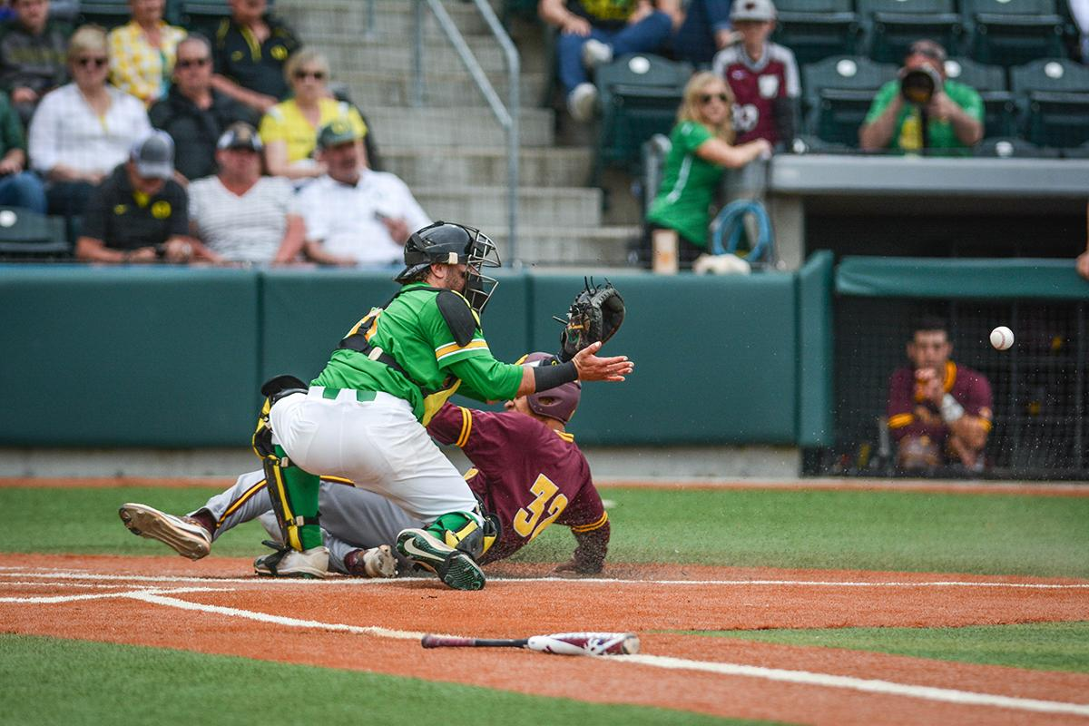 Sun Devils Garvin Alston Jr. (#32) slides in and beats the throw home. Despite a late comeback, the Ducks fall to Arizona State Sun Devils 4-3 in the second game of a three-game series. Photo by Jacob Smith, Oregon News Lab