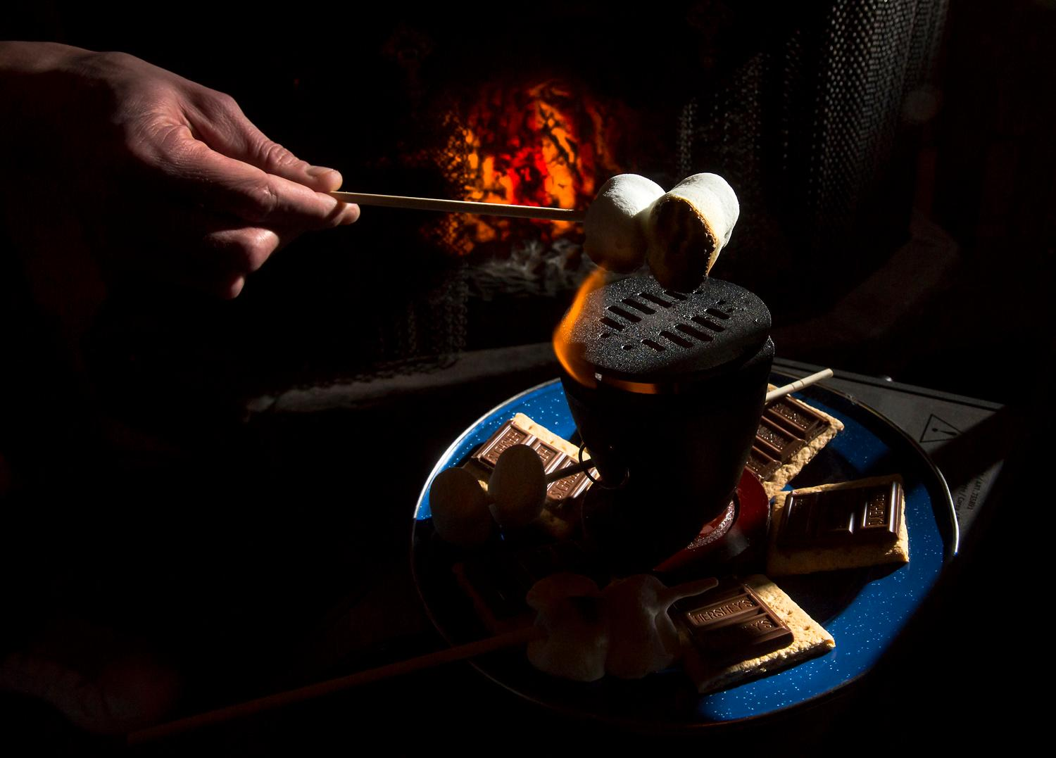 "A classic at Camp Bar is the tabletop s'mores. Inspired by some of his favorite wateringholes, owner Patrick Haight opened the bar in August 2017, but took a fun, tongue-in-cheek approach to the classic PNW vibe. The bar's slogan is ""where adults go to camp,"" and with deer heads hanging on the wall, folding camping chairs, and the classic buck hunter arcade game to play, it sure feels like it. If you are passing through Tacoma, don't miss this place! (Sy Bean / Seattle Refined)"