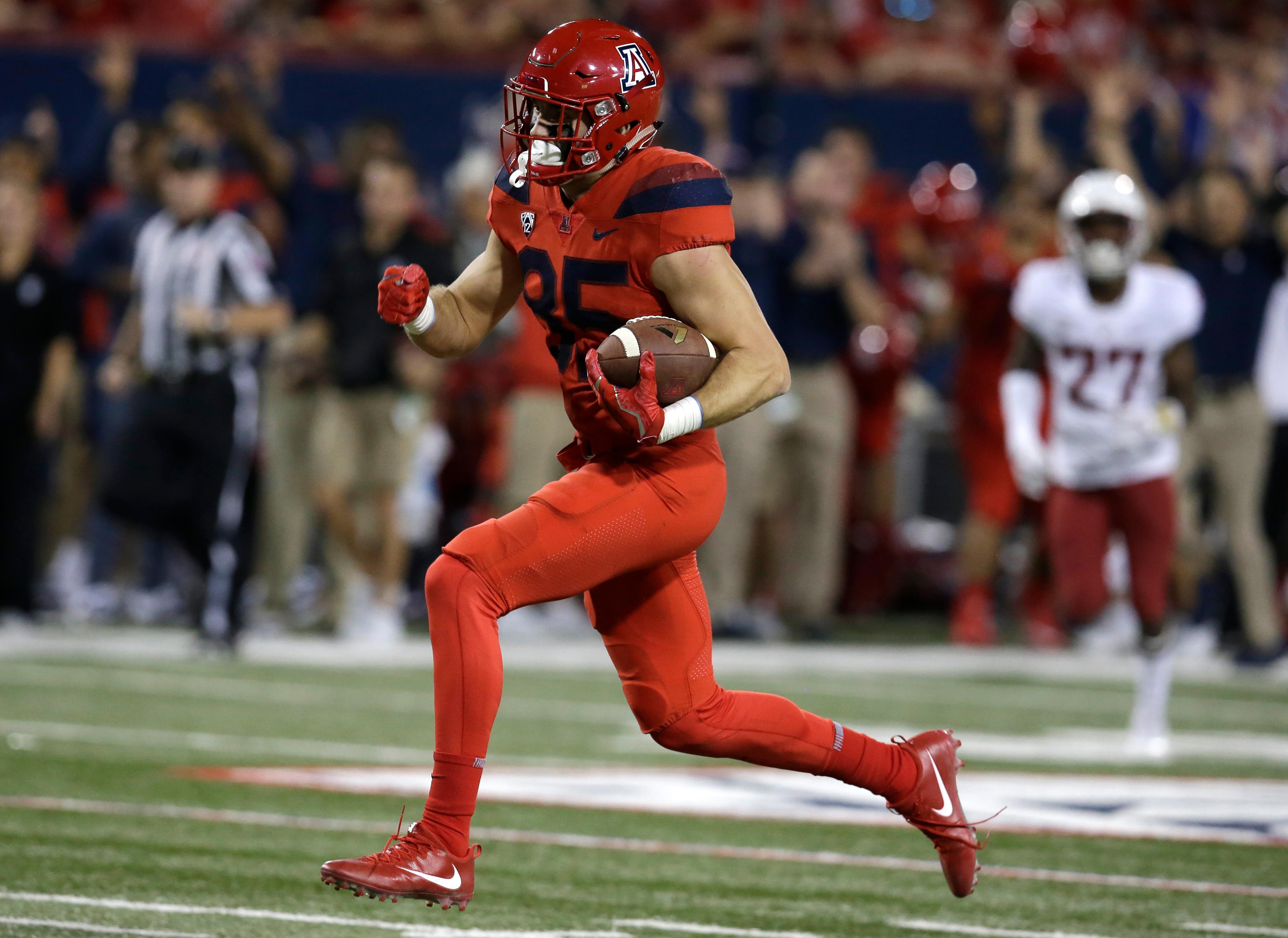 Arizona tight end Jamie Nunley scores a touchdown in the first half during an NCAA college football game against Washington State, Saturday, Oct. 28, 2017, in Tucson, Ariz. (AP Photo/Rick Scuteri)