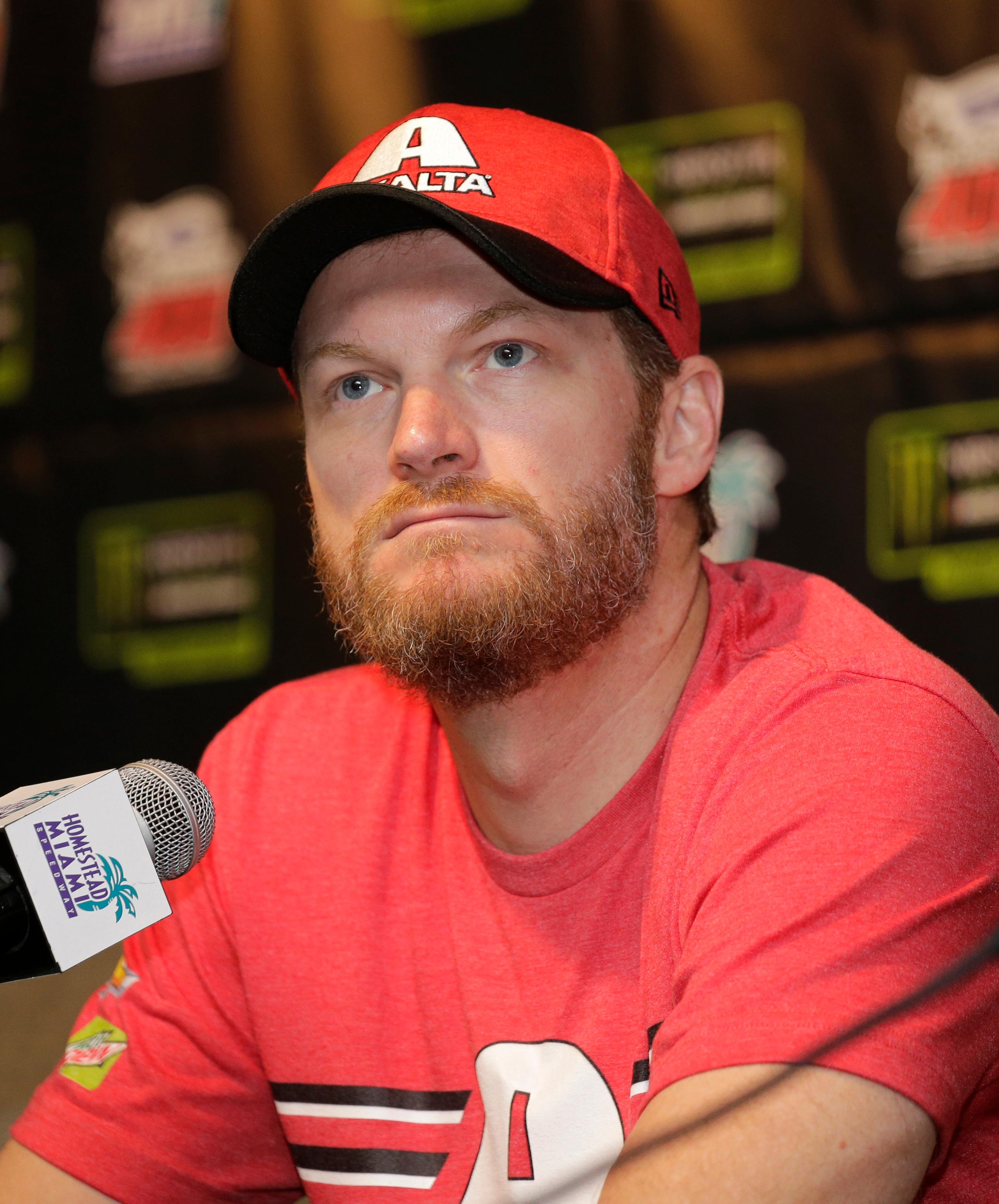 Dale Earnhardt Jr. speaks with the media during a news conference before Sunday's NASCAR Cup Series auto race at Homestead-Miami Speedway in Homestead, Fla., Friday, Nov. 17, 2017.(AP Photo/Terry Renna)