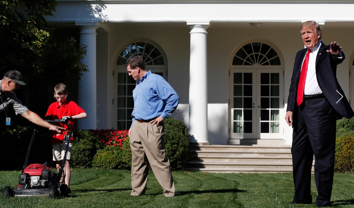 (AP PHOTO) Frank Giaccio, 11, of Virginia, is surprised by President Donald Trump on Friday while mowing the lawn of the Rose Garden at the White House in Washington.