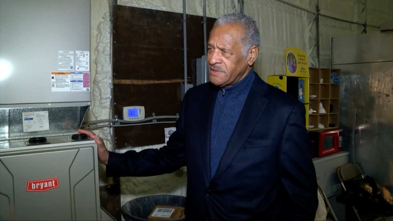 Bishop R.L. Jones, pastor of Greater Holy Temple Church of God in Christ in Flint, grateful for donation of new central air system installed by Goyette Mechanical at R.L. Jones Community Outreach Center.