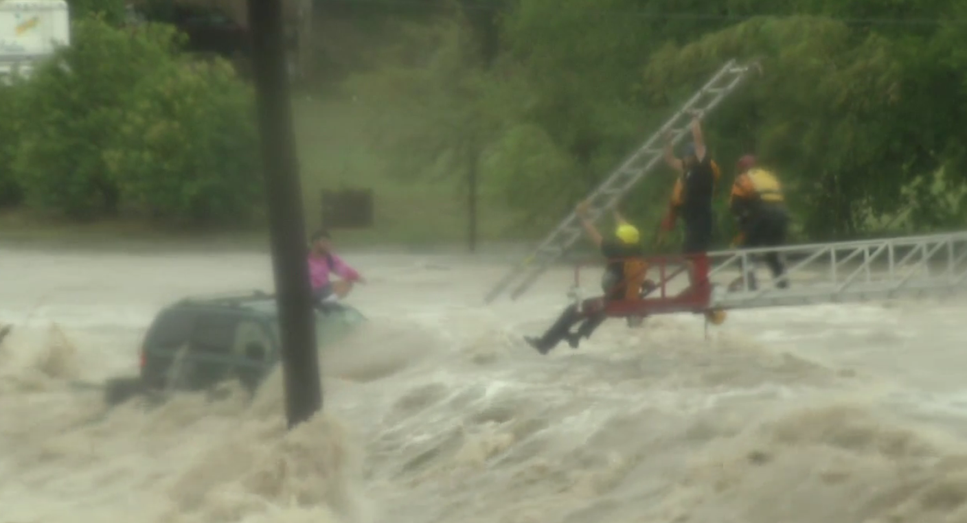 Emergency crews work to save driver from flood waters in Texas Monday, August 7,2017.(KABB/WOAI)