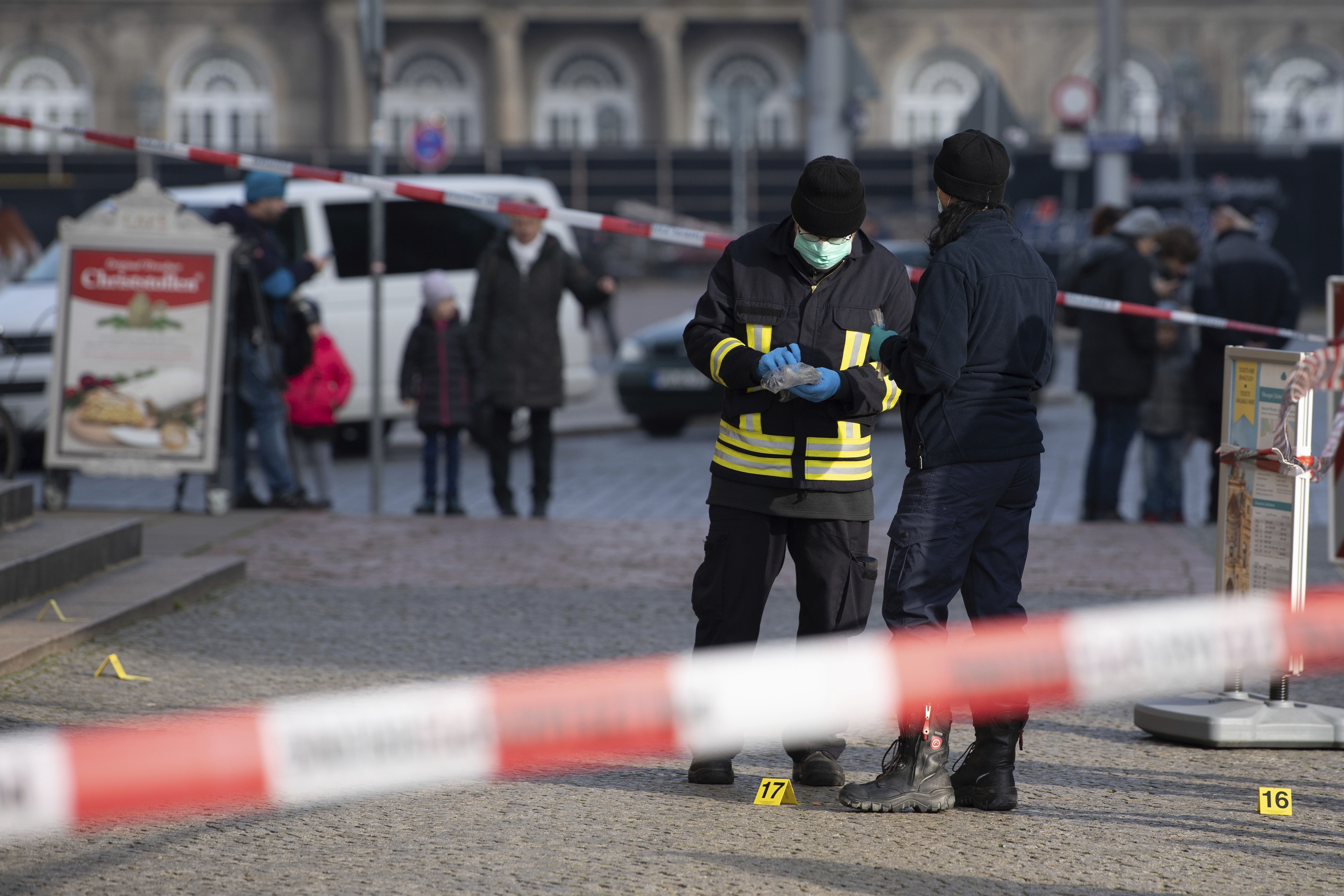 Police officers stand behind a caution tape at the Schinkelwache building in Dresden Monday, Nov. 25, 2019.{ } (Sebastian Kahnert/dpa via AP)