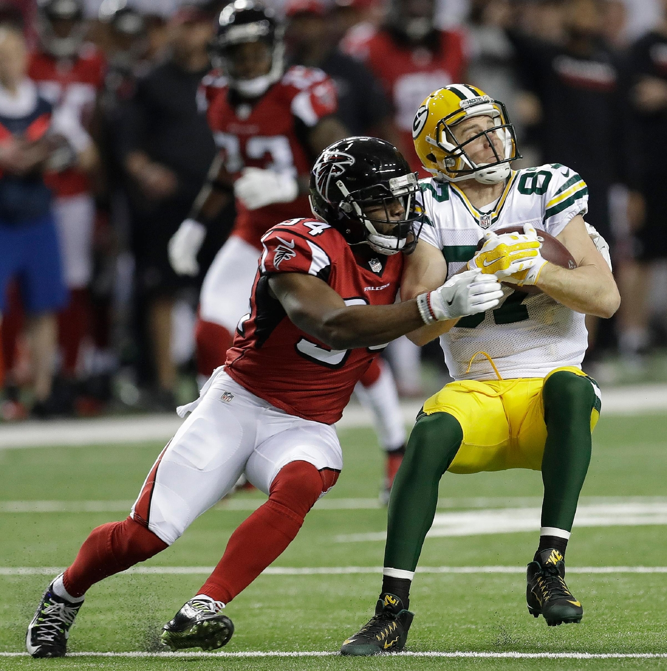Green Bay Packers' Jordy Nelson catches a pass in front of Atlanta Falcons' Brian Poole during the first half of the NFC championship game, Sunday, Jan. 22, 2017, in Atlanta. (AP Photo/David J. Phillip)