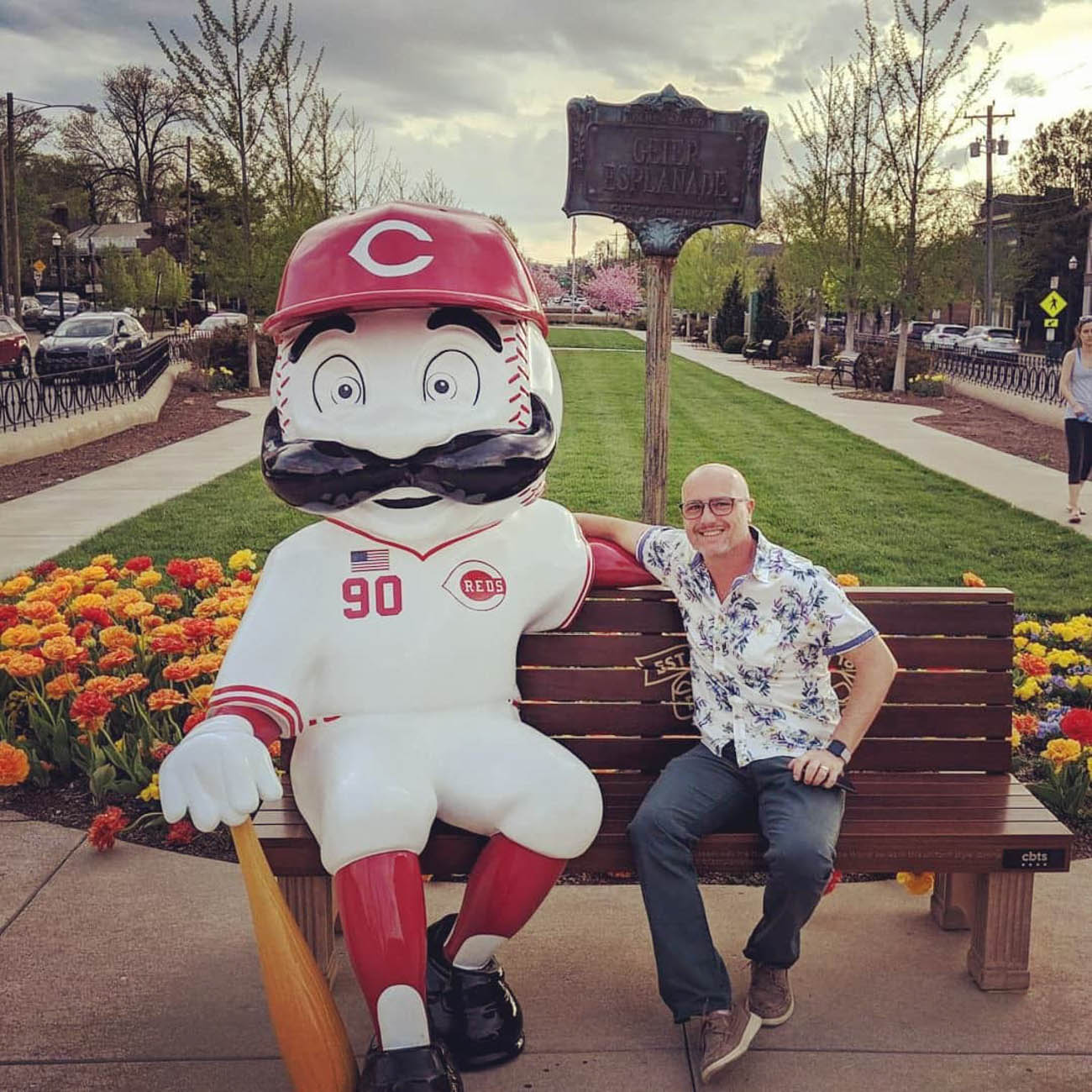 To celebrate the Reds' 150th Anniversary, 24 benches featuring Mr. Redlegs sculptures have been added to various spots around the area, as well as out of town locations including Dayton, Loveland, and Louisville, for the perfect Reds photo op. The mascot sports different uniforms from throughout the team's history at each of the benches. The Reds have been wearing these same throwback uniforms during their 2019 season. / Location: Oakley Square / Uniform: 1990 / Image courtesy of Instagram user @ryandale1976_   // Published: 5.14.19{ }