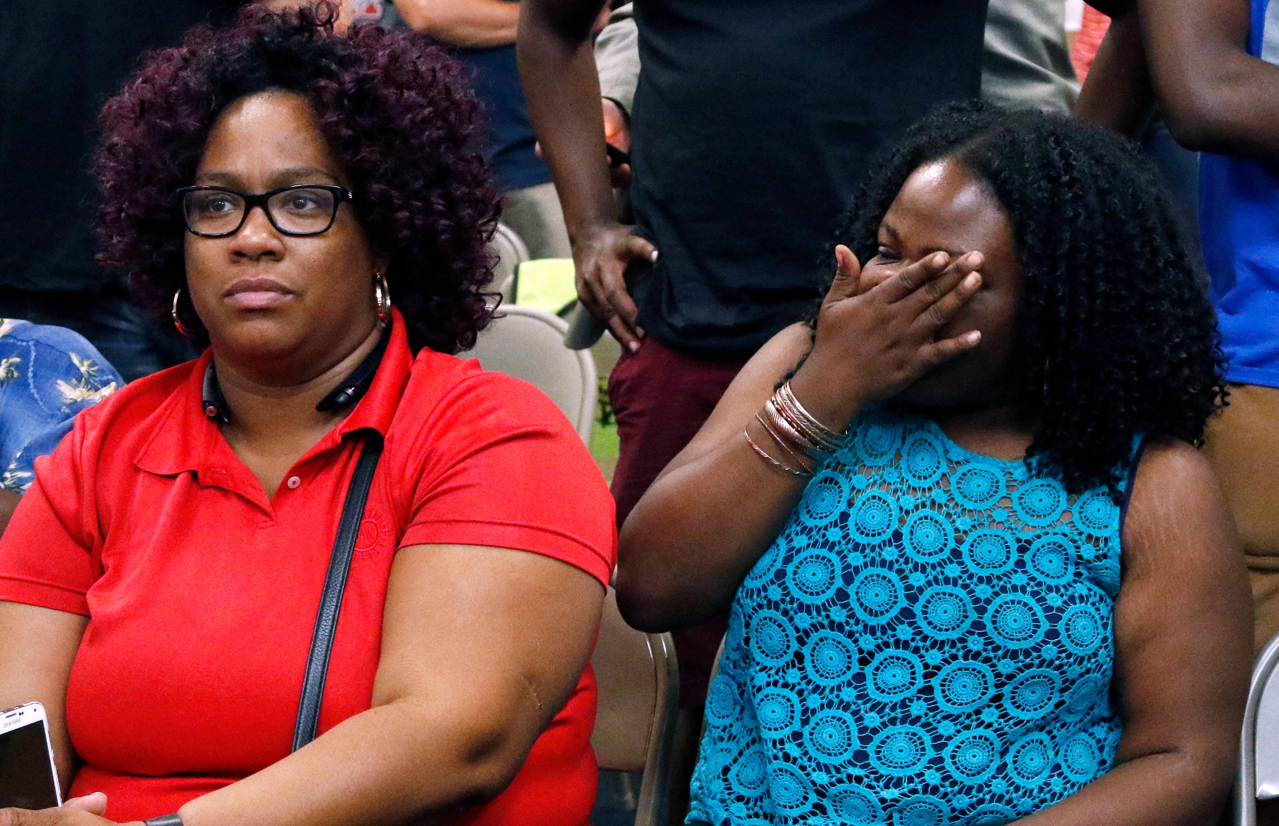 United Auto Workers members, some Nissan employees and supporters express their disappointment at losing their bid to form a union at the Nissan vehicle assembly plant in Canton, Miss., Friday, Aug. 4, 2017.  (AP Photo/Rogelio V. Solis)