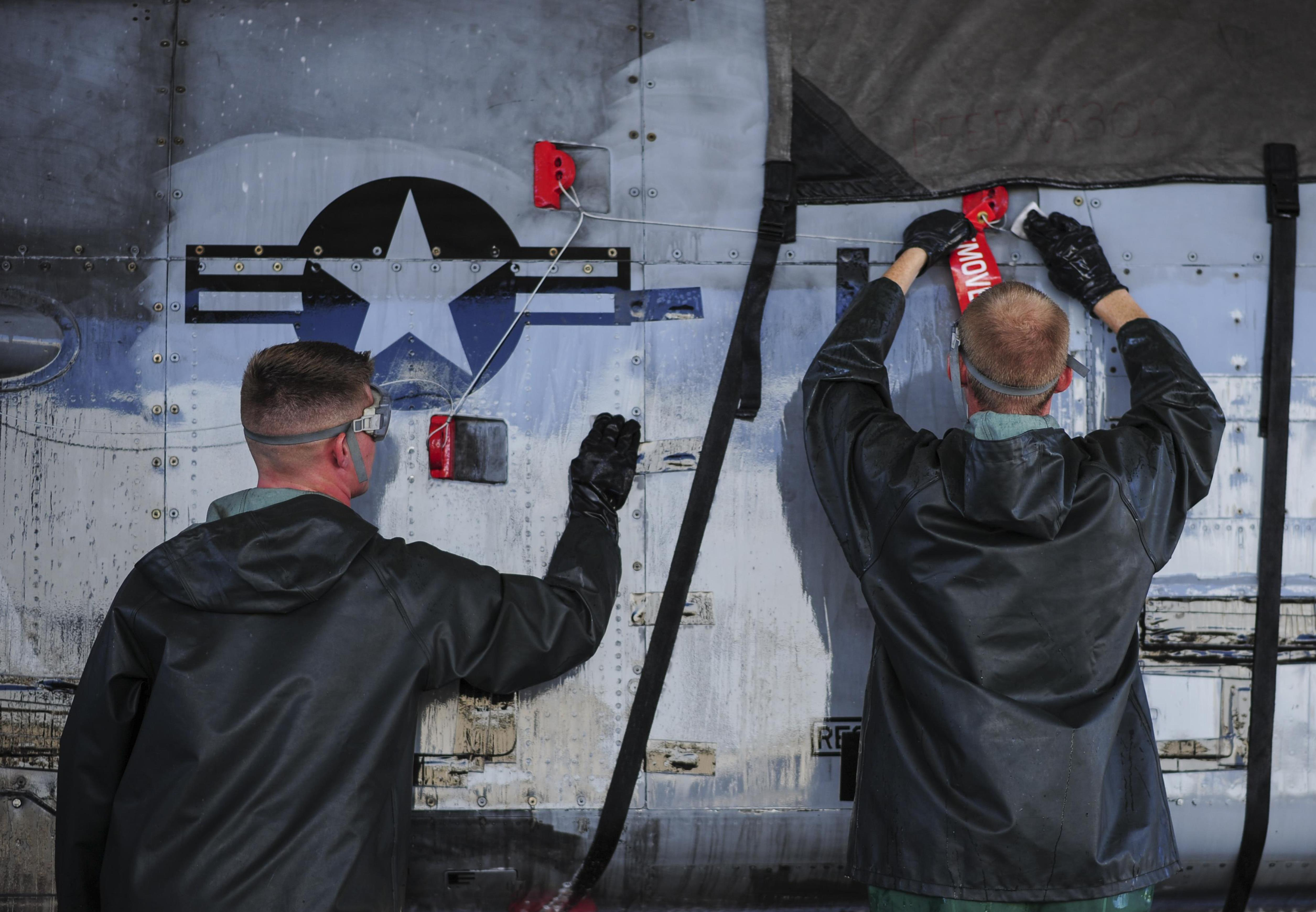 Airman 1st Class Jacob Mitchell and Senior Airman Caleb Mathre, 354th Aircraft Maintenance Unit crew chiefs, clean an A-10C Thunderbolt II at Davis-Monthan Air Force Base, Ariz., July 25, 2017. The detailed cleaning process can take crew chiefs nearly four hours to complete. (U.S. Air Force photo/Airman 1st Class Michael X. Beyer)