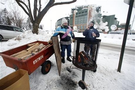 Green Bay Packers fans gather around the fire as they tailgate before an NFL wild-card playoff football game between the Green Bay Packers and the San Francisco 49ers, Sunday, Jan. 5, 2014, in Green Bay, Wis.