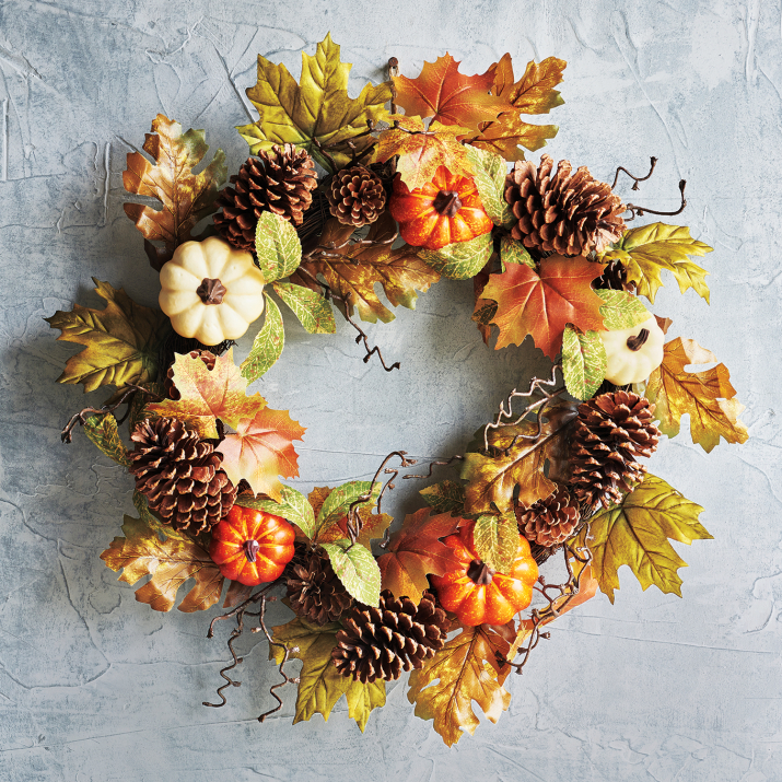 For the more traditional route, Sur La Table has a variety of wreaths but my favorite has to be their Pumpkin Wreath (Image: Sur La Table)