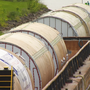 One dozen steel tanks traveling to Genesee Brewery make their way through CNY