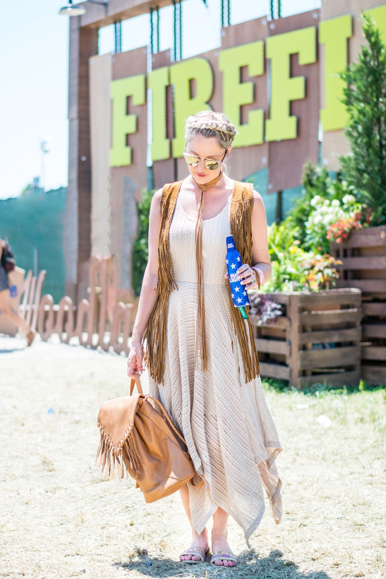 For the final day, Lacey pulled out all the fringe in her suitcase, including making a choker necklace out of the fringe belt that came with her dress. (Image: Lacey Faeh)