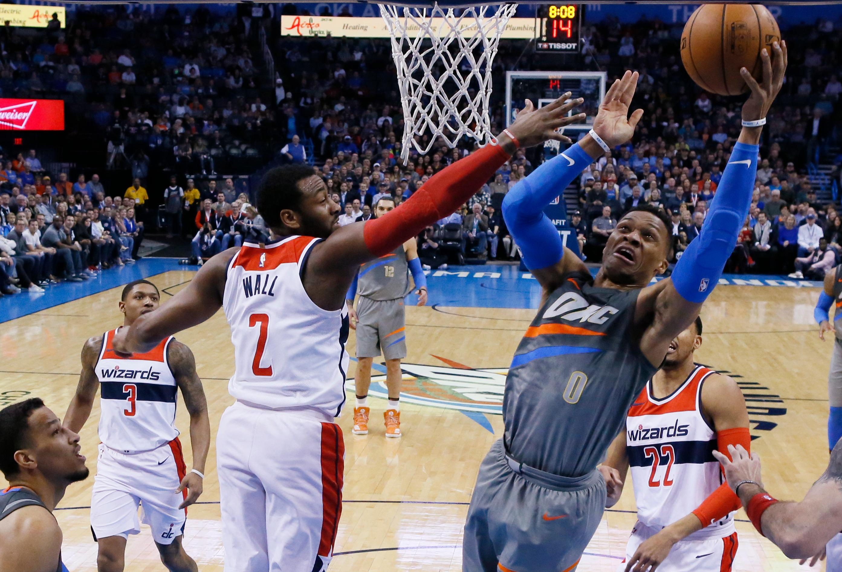 Oklahoma City Thunder guard Russell Westbrook (0) shoots as Washington Wizards guard John Wall (2) defends during the first quarter of an NBA basketball game in Oklahoma City, Thursday, Jan. 25, 2018. (AP Photo/Sue Ogrocki)
