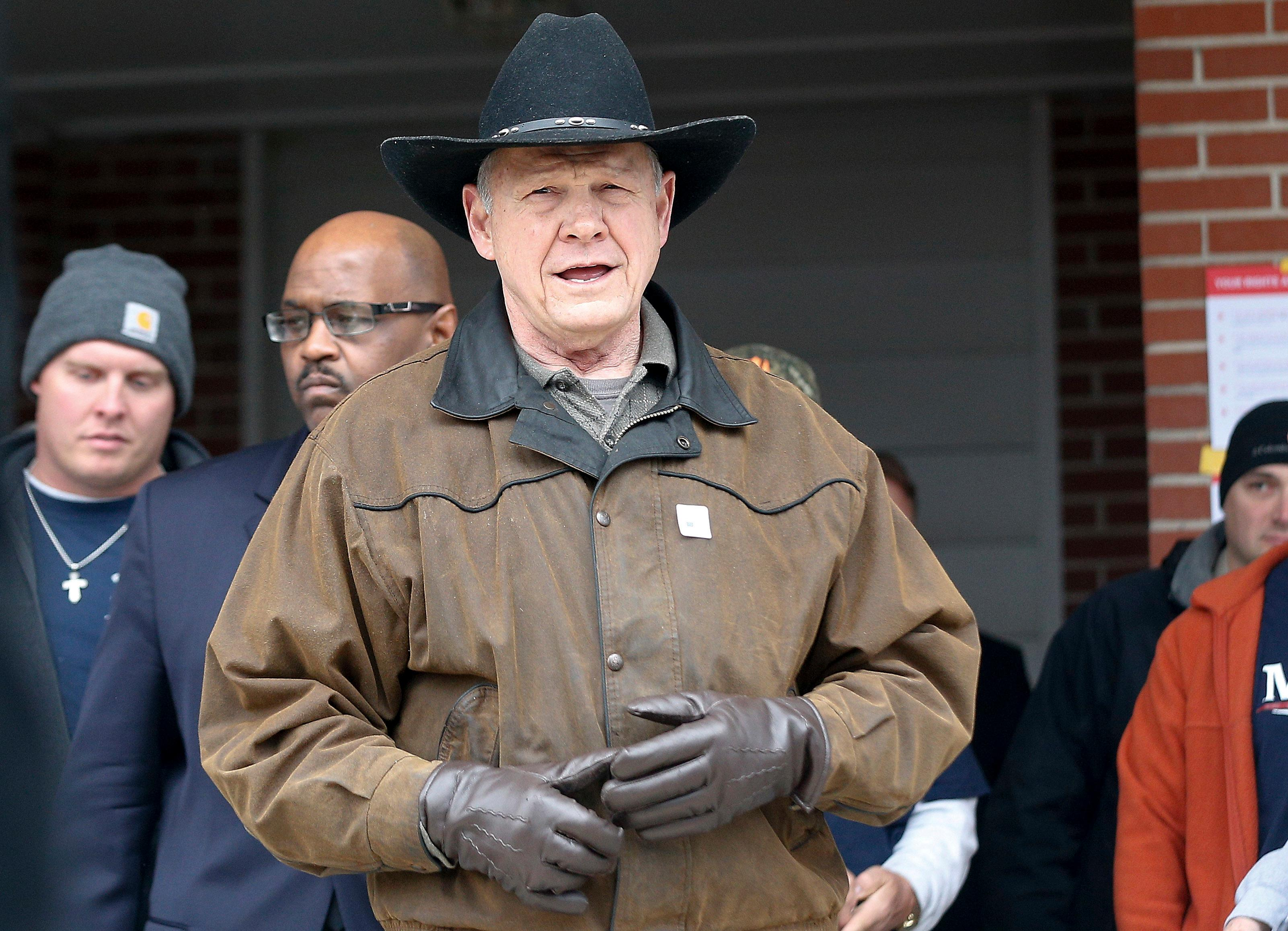 U.S. Senate candidate Roy Moore speaks to the media after he rode in on a horse to vote, Tuesday, Dec. 12, 2017, in Gallant, Ala. Alabama voters are deciding between Moore, former chief justice of the Alabama Supreme Court and Democrat Doug Jones.  (AP Photo/Brynn Anderson)