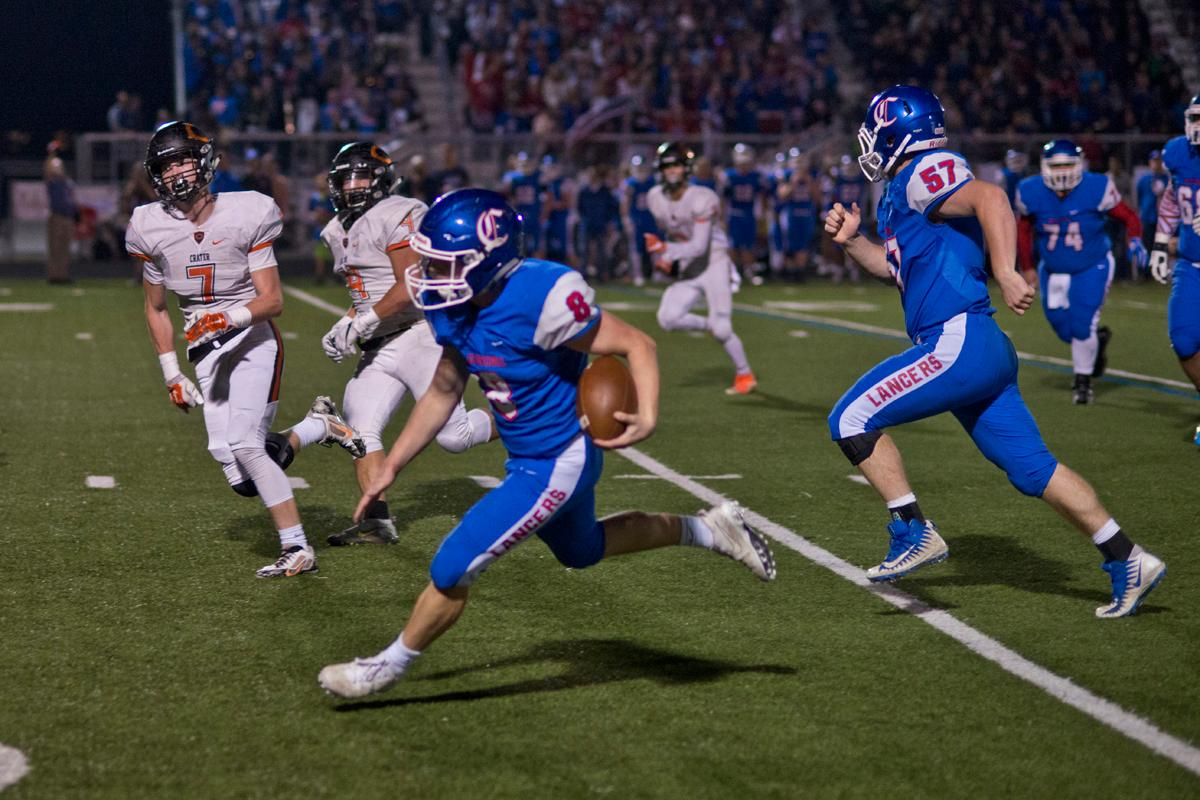 Churchill Lancers running back Dalton McDaniel (#8) powers toward to end zone in the game against the Crater Comets. Churchill defeated Crater 63-21 on Friday at their homecoming game. Churchill remains undefeated with a conference record of 9-0. Photo by Dan Morrison, Oregon News Lab