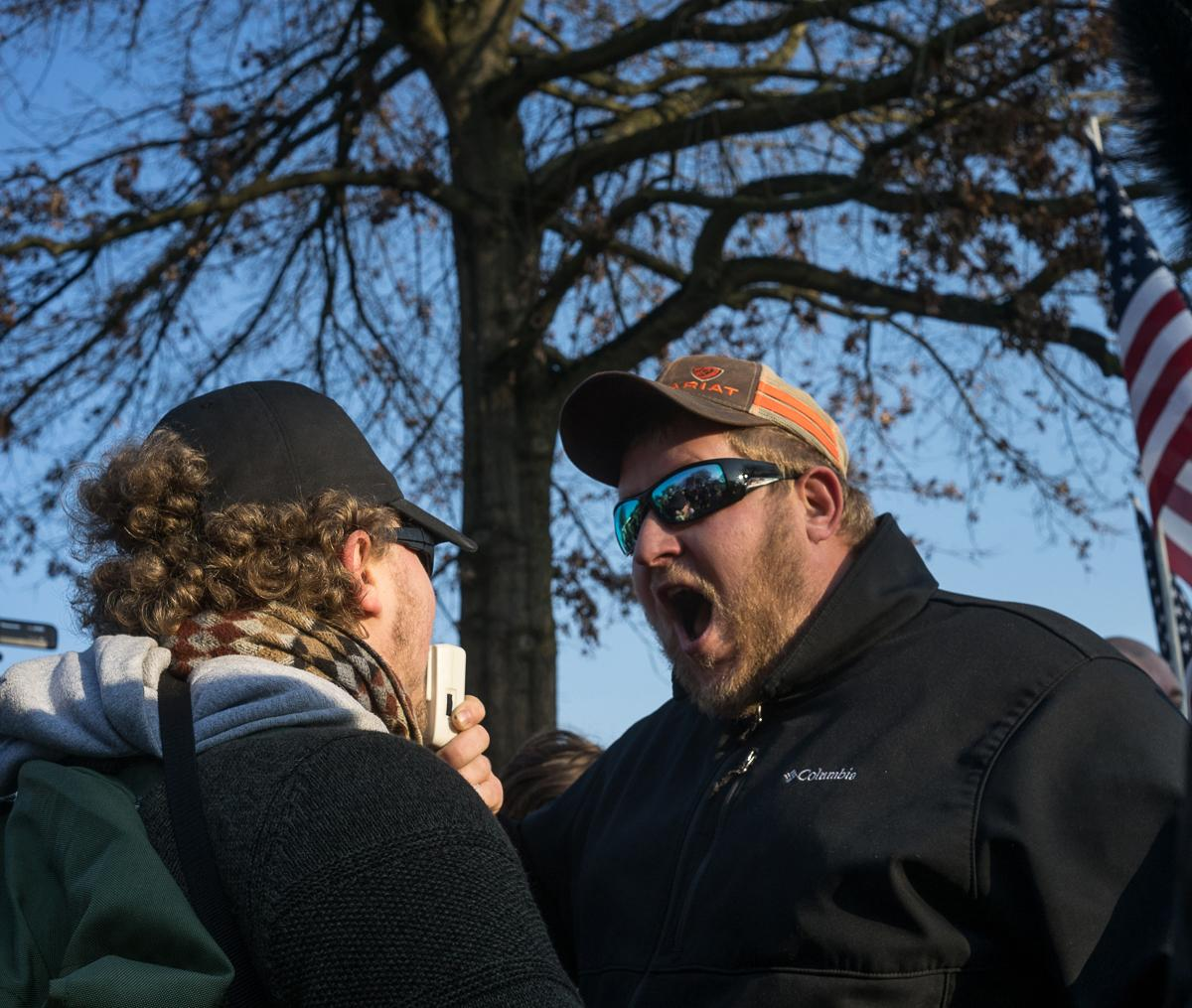 An attendee of the Patriot Prayer rally (right) engages in a heated exchange with a counter-protester (left). A demonstration by the alt-right, conservative group Patriot Prayer began at 1 p.m. in Portland, Ore., on Saturday, December 9, to protest the homicide acquittal of Jose Ines Garcia Zarate, the undocumented immigrant who accidentally shot and killed Kate Steinle in San Francisco. The demonstration attracted a large crowd of counter-protesters and members of Antifa, and heated exchanges and several scuffles occurred between the two groups throughout the afternoon until the event's conclusion at 4 p.m., with at least one member of Patriot Prayer being detained by police and several demonstrators being injured. The rally began in Portland's Terry Schrunk Plaza and developed into a march along the Tom McCall Waterfront Park before ending at Terry Schrunk Plaza again. Photo by Kit MacAvoy, Oregon News Lab