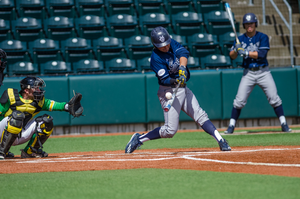 Mikey Duarte (1) makes contact with the ball as Mathew Dyer (7) prepares to make the catch.In the second of the three game series, the Ducks beat the UC Irvine Anteaters 6-3. Photo by Levi Gittleman, Oregon News Lab