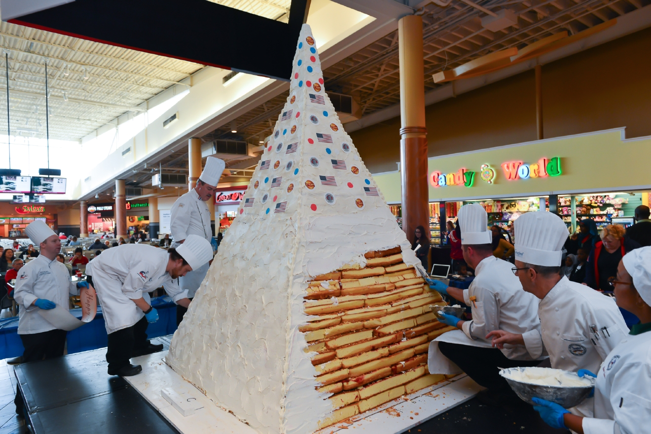 Stratford Chefs busily complete icing of the Guinness World Records record-breaking cake. (Image: Courtesy Stratford University)