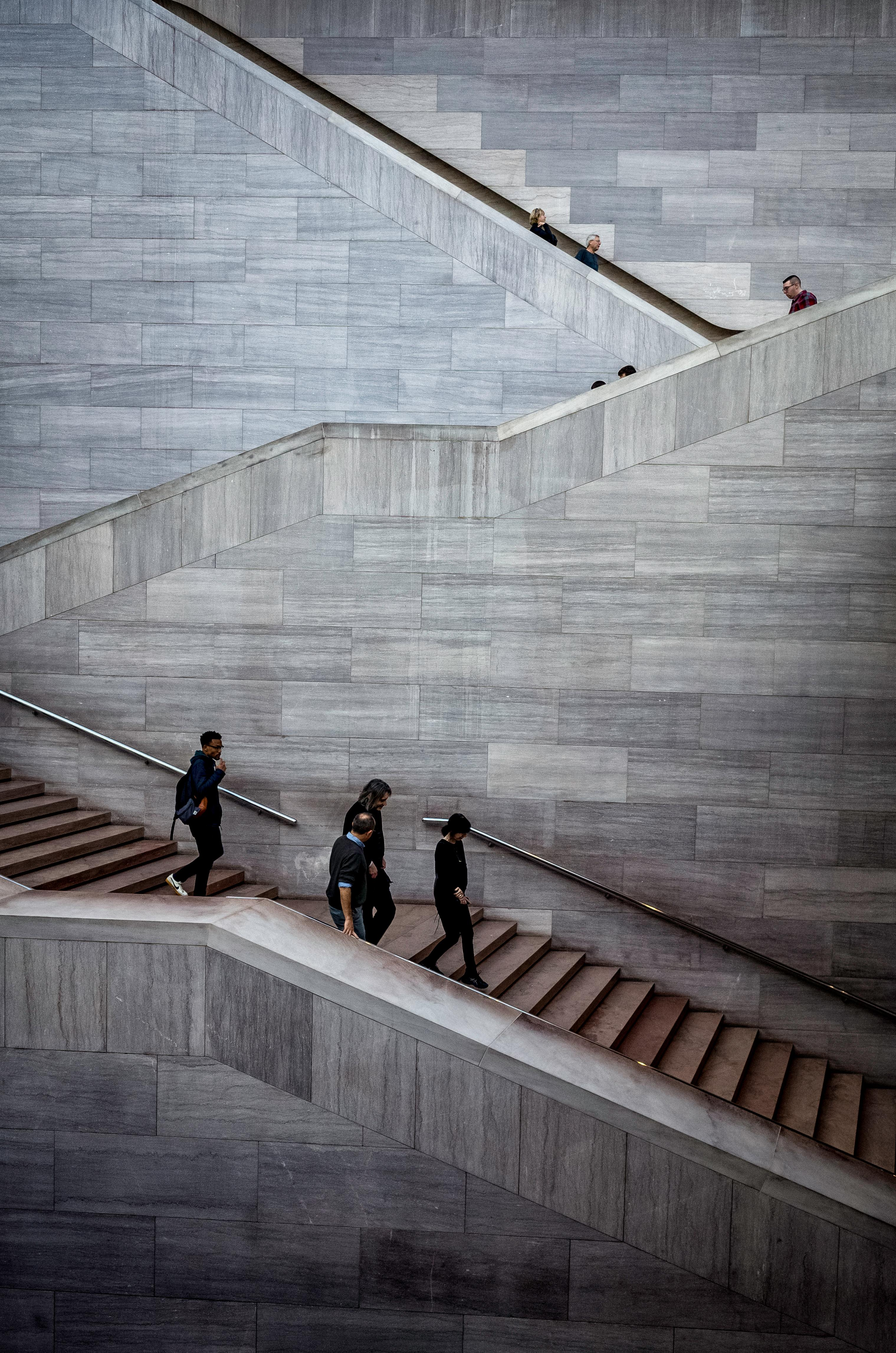 People going up and down the stairs at the National Gallery of Art. Taken January, 2018. (Image: Adam Brockett)