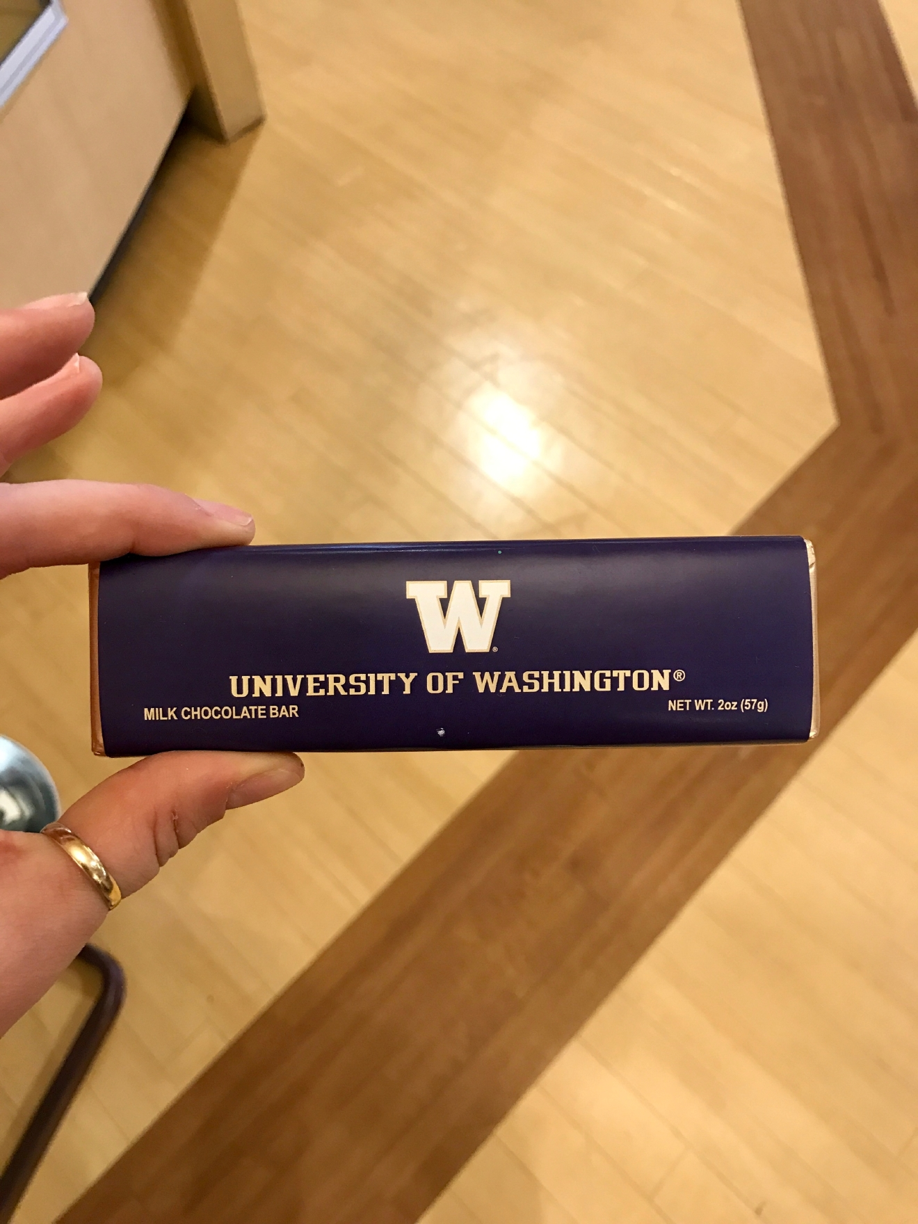 Husky Chocolate - $3.95                                          Whether you're a current student, alum, or just *love* the Dawgs, it's a pretty exciting time to be a Husky fan right now. Just to catch you up, the University of Washington football team is having one of their best seasons in years, and will be playing the Peach Bowl in Atlanta on December 31st. If you know a Dawg fan, they're probably salivating at the mouth right about now. Which is why it's a perfect time to give them a themed gift! Here are some of the coolest Husky gear we saw at the University Bookstore on the Avenue during our last visit. Pro Tip: They're open 10 a.m. - 7 p.m. on Christmas Eve! (Image: Britt Thorson / Seattle Refined)