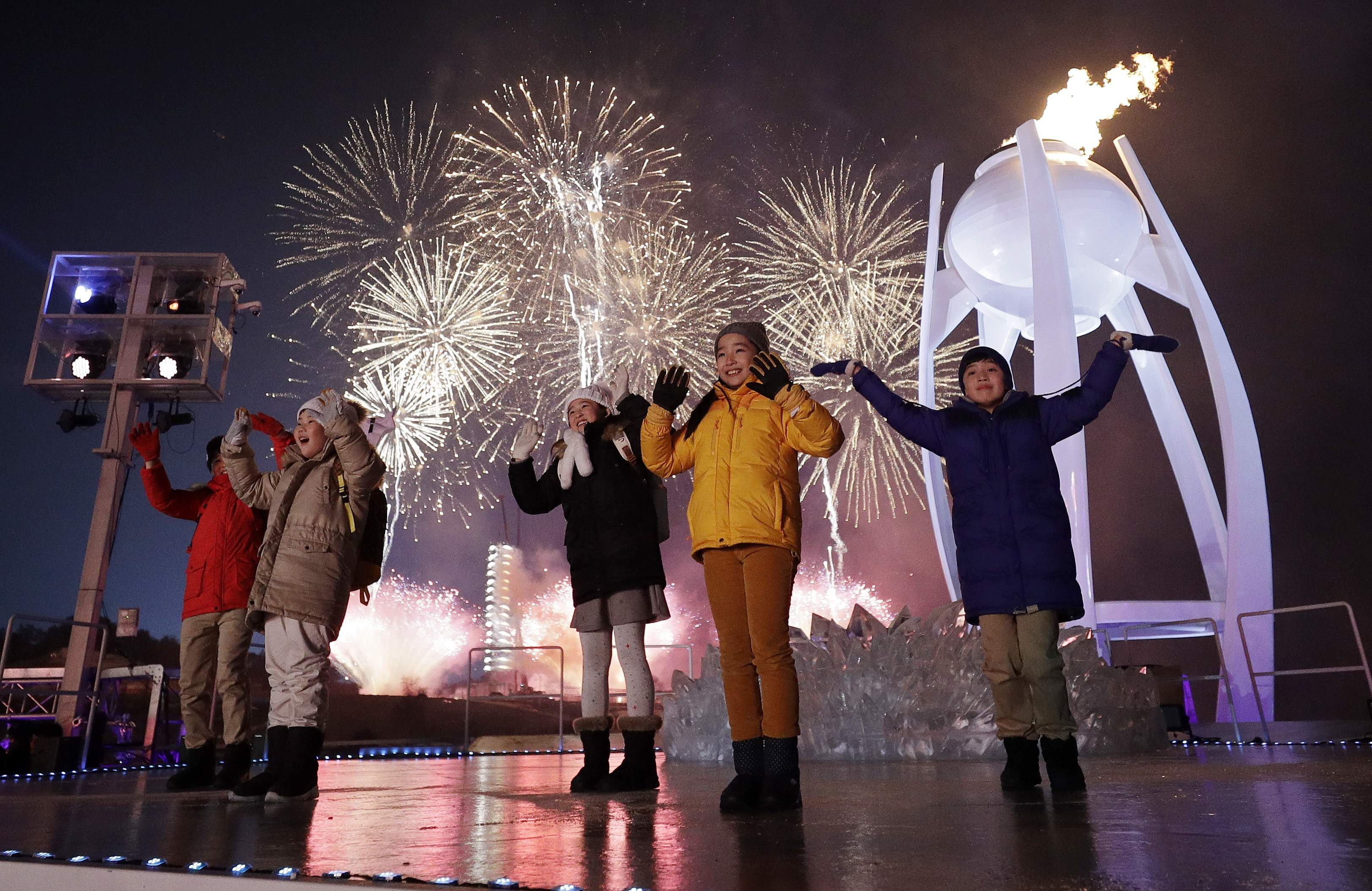 Performers dance as fireworks explode over the opening ceremony of the 2018 Winter Olympics in Pyeongchang, South Korea, Friday, Feb. 9, 2018. (AP Photo/David J. Phillip,Pool)