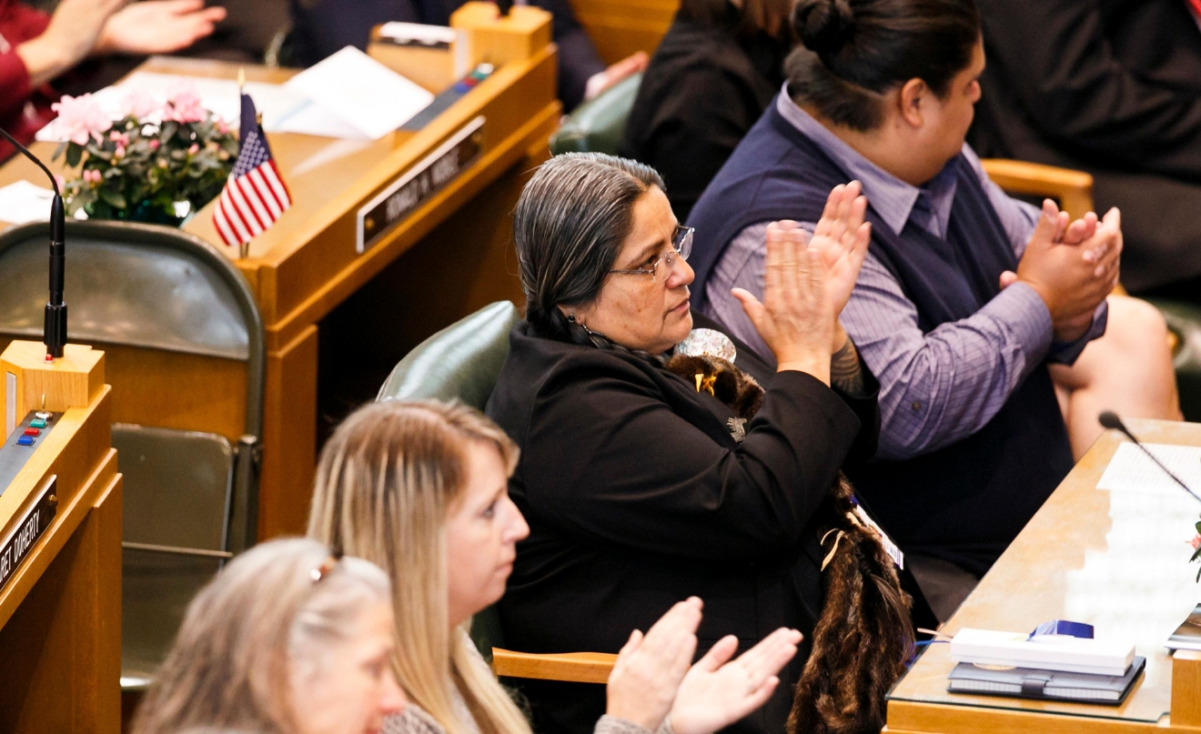 Tawna Sanchez applauds following the inauguration of Gov. Kate Brown,  Monday,