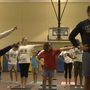 USC Quarterback & Tight End do yoga with autistic children
