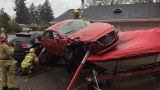 Crash sends car into boat in NW Portland