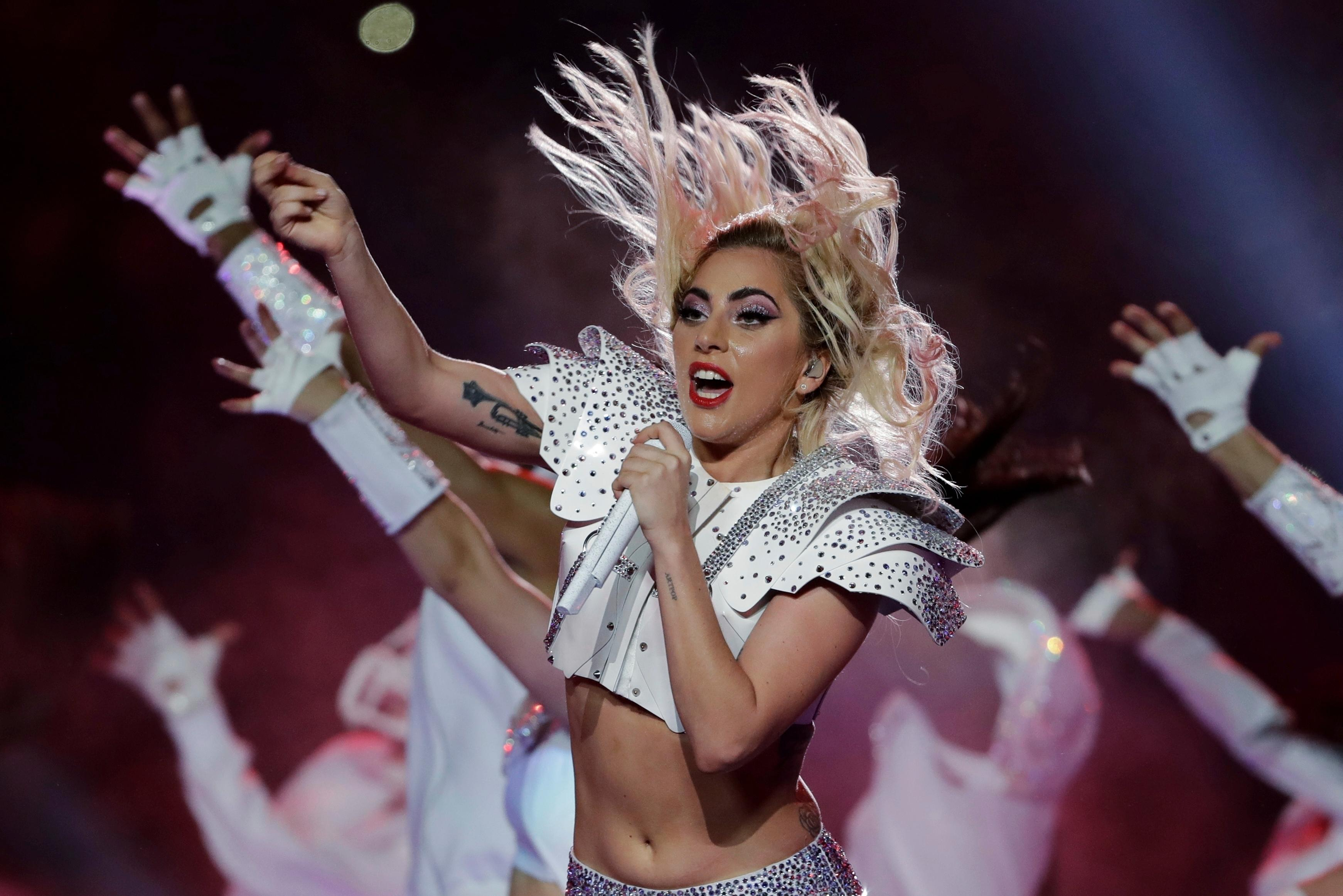 FILE - In this Feb. 5, 2017, file photo, Lady Gaga performs during the halftime show of the NFL Super Bowl 51 football game between the New England Patriots and the Atlanta Falcons in Houston. Starbucks announced June 12, 2017, that it's teaming with Gaga for a set of brightly colored summery drinks that will raise money for the singer's foundation. (AP Photo/Matt Slocum, File)