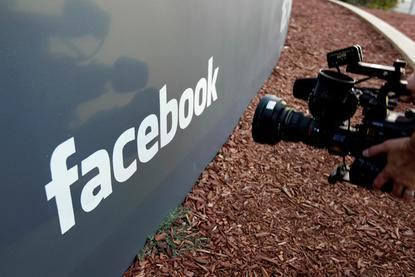 Facebook accused of acting like 'digital gangster' in UK