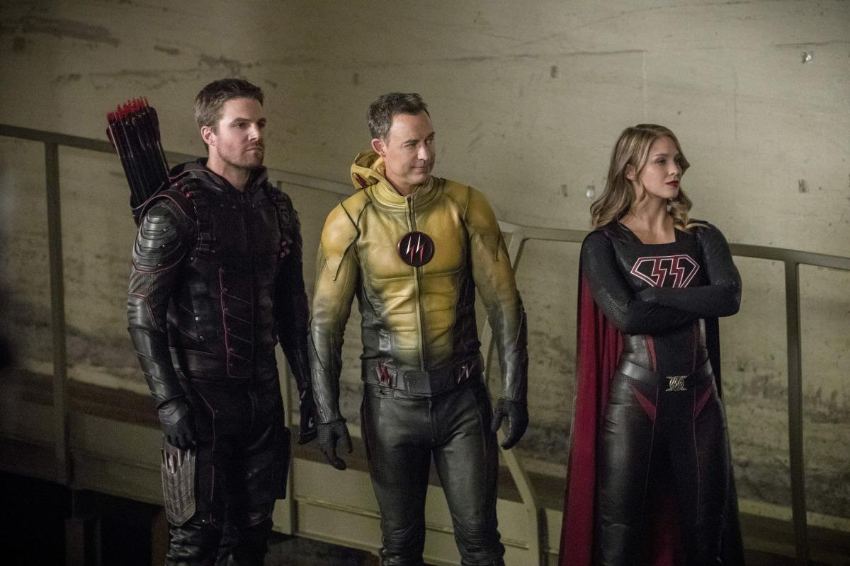 "Arrow -- ""Crisis on Earth-X, Part 2"" -- AR608a_0705b.jpg -- Pictured (L-R): Stephen Amell as Dark Arrow, Tom Cavanagh as Dark Flash, and Melissa Benoist as Overgirl -- Photo: Jack Rowand/The CW -- �© 2017 The CW Network, LLC. All Rights Reserved"