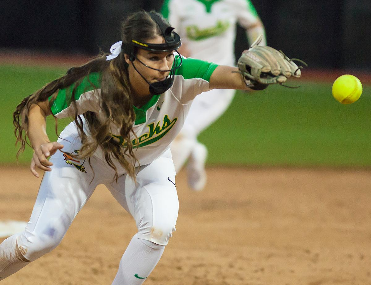 Oregon utility player Nikki Udria (#3) reaches to catch the ball. In the first of a three game series the Oregon Ducks defeated the California Golden Bears five to one. Photo by Ben Lonergan, Oregon News Lab