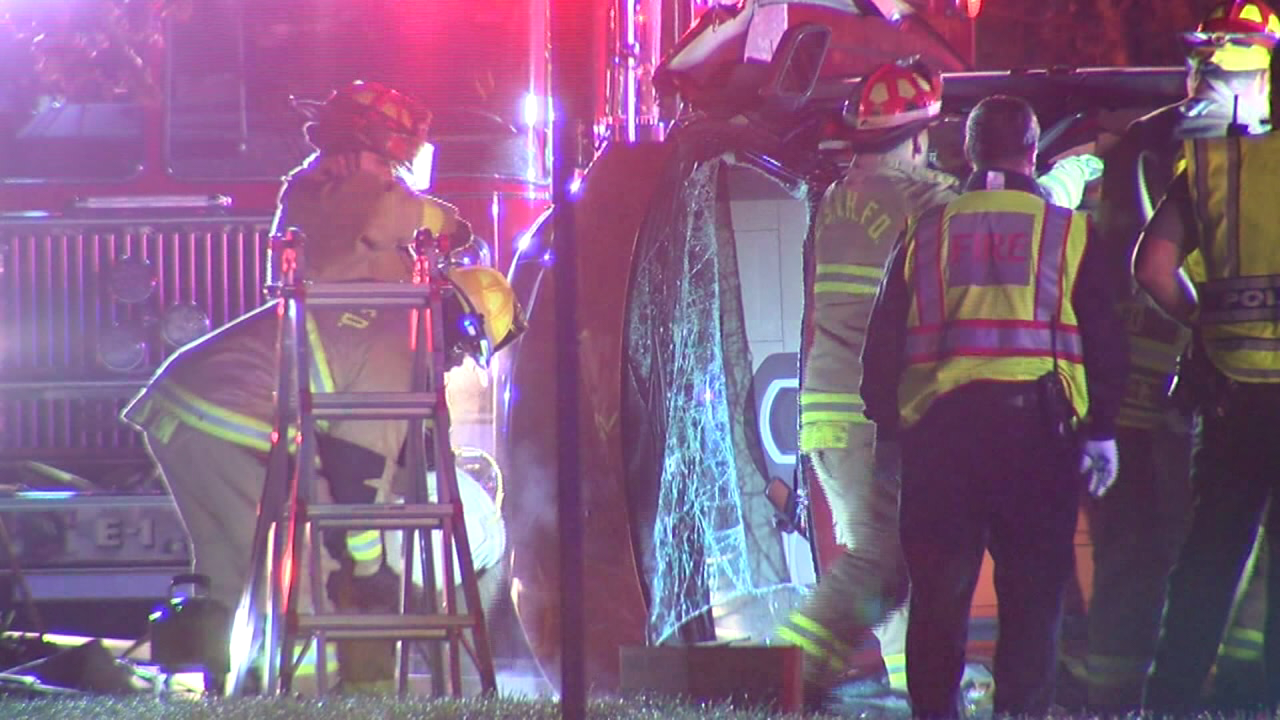 Vehicle overturned after hitting a hole on Dixie Highway (WKRC)