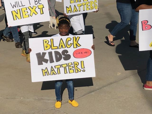 <p>Black Lives Matter activists held a protest Friday night to demand a Woods Cross officer who pointed a gun at a 10-year-old boy be fired. (Photo: Jim Spiewak / KUTV)</p>