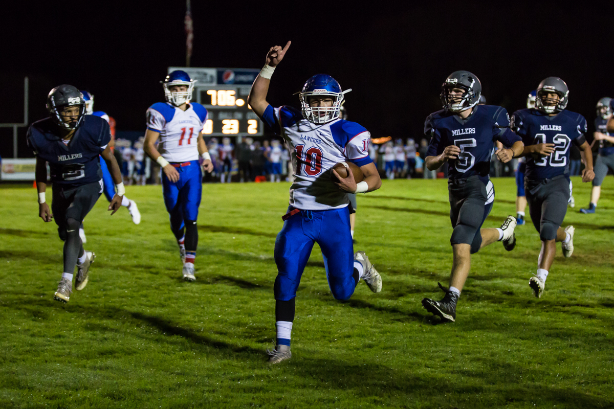 Churchill running back Tyson Bennion (#10) celebrates as he crosses into the end zone. The Churchill Lancers defeated the Springfield Millers 56-7 in a cold game Friday night. Friday night's win extended Churchill's season to 7-0. Photo by Dillon Vibes