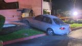 Apartment dweller dead after car crashes through wall