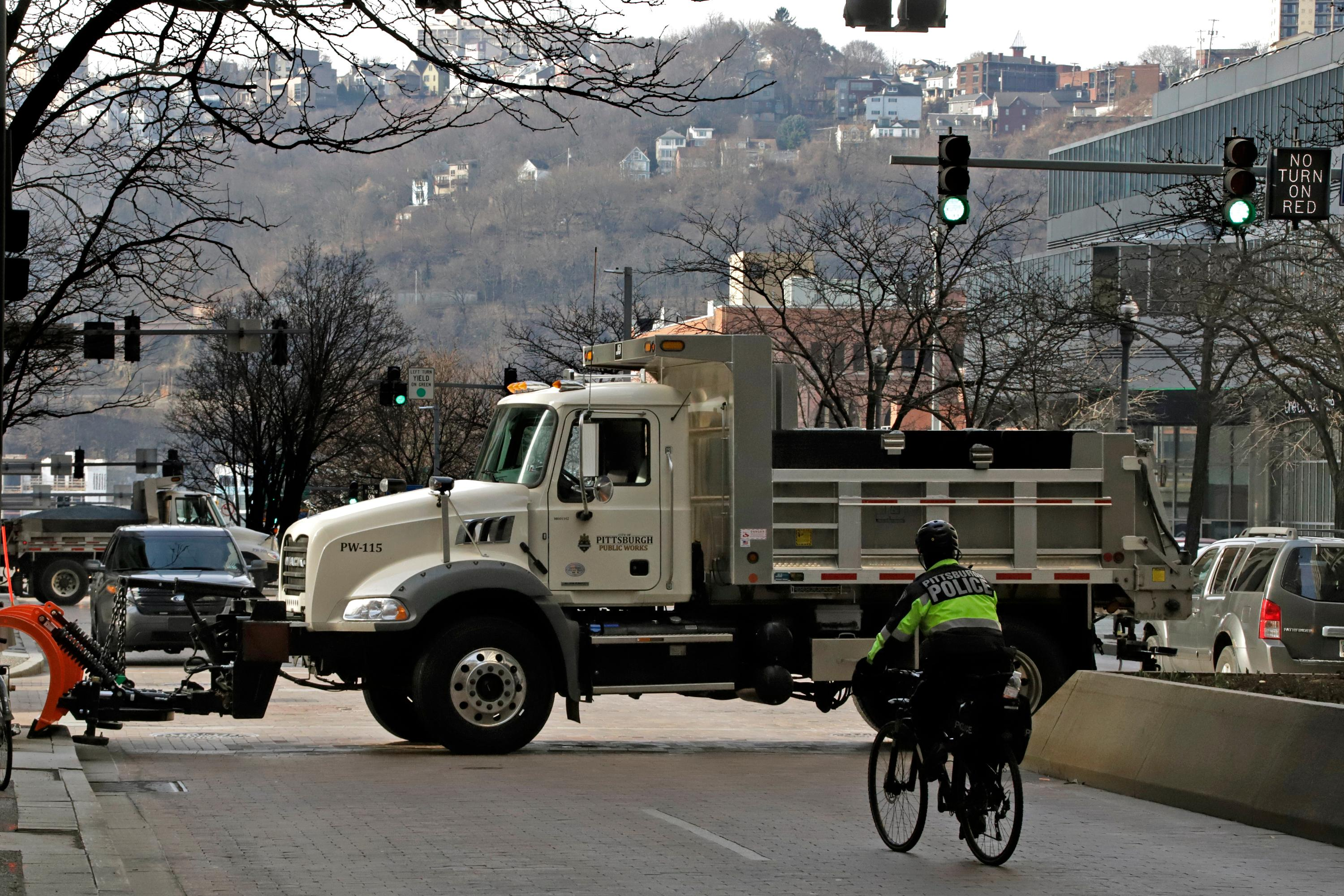 A Pittsburgh public works trucks block traffic on Grant St. in front of the Allegheny County Courthouse on the second day of the trial for Michael Rosfeld, a former police officer in East Pittsburgh, Pa., Wednesday, March 20, 2019.(AP Photo/Gene J. Puskar)