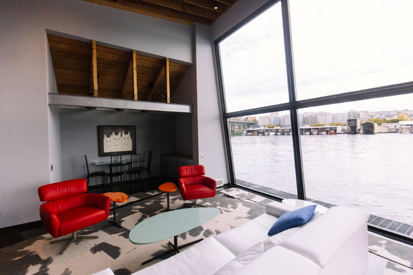 The 2016 Floating Home Tour featured thirteen floating homes along Portage Bay. We were able to sneak into a couple early, and will profile one a day for the next week. Next up is this little POP of color on the water. Enjoy! (Image: Joshua Lewis / Seattle Refined)