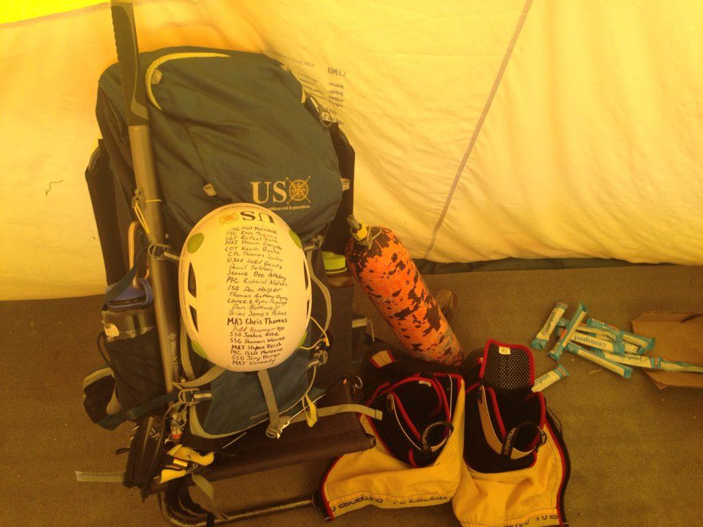 Harold Earls' pack before the final summit push. On his helmet are names of fallen soldiers he was climbing in memory of.
