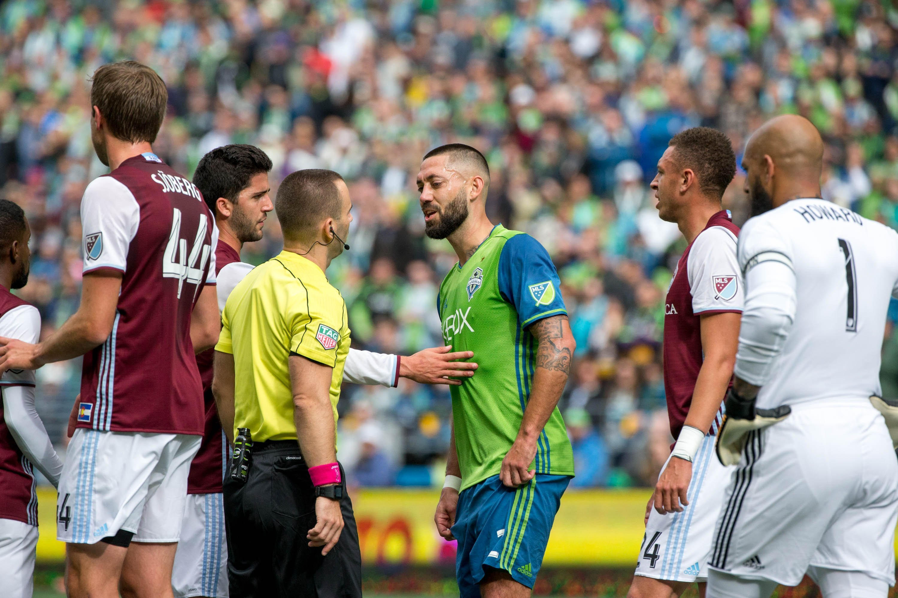 Seattle Sounders midfielder Clint Dempsey (2) speaks to the referee after receiving a red card during the first half of an MLS soccer game against the Colorado Rapids in Seattle on Sunday, Oct. 22, 2017. (Courtney Pedroza/The Seattle Times via AP)