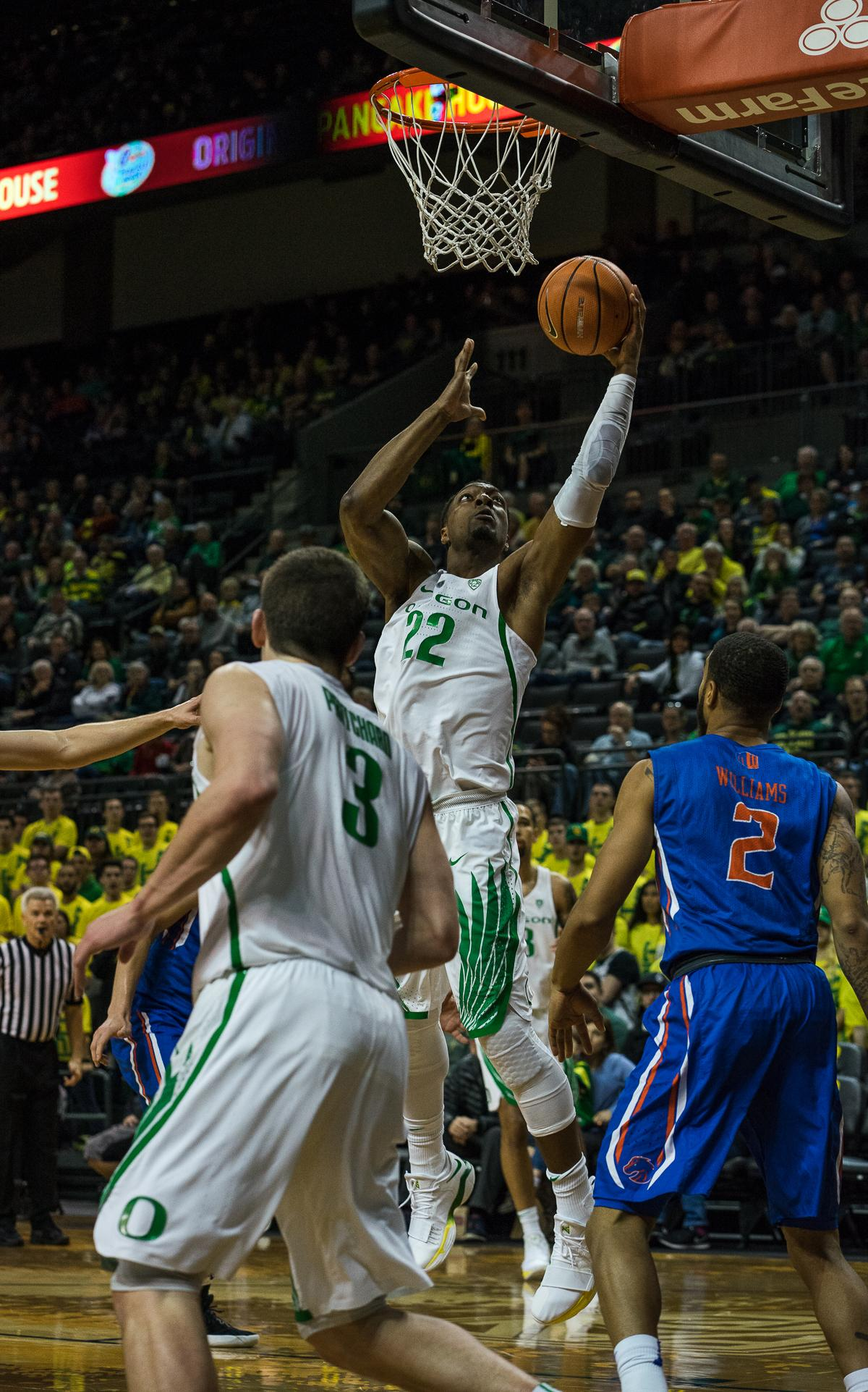 University of Oregon Duck MiKyle McIntosh (#22) completes a layup as Boise State Bronco Lexus Williams (#2) looks on. The Boise State Broncos defeated the University of Oregon Ducks 73 – 70 at Matthew Knight Arena in Eugene, Ore., on December 1, 2017. Photo by Kit MacAvoy, Oregon News Lab